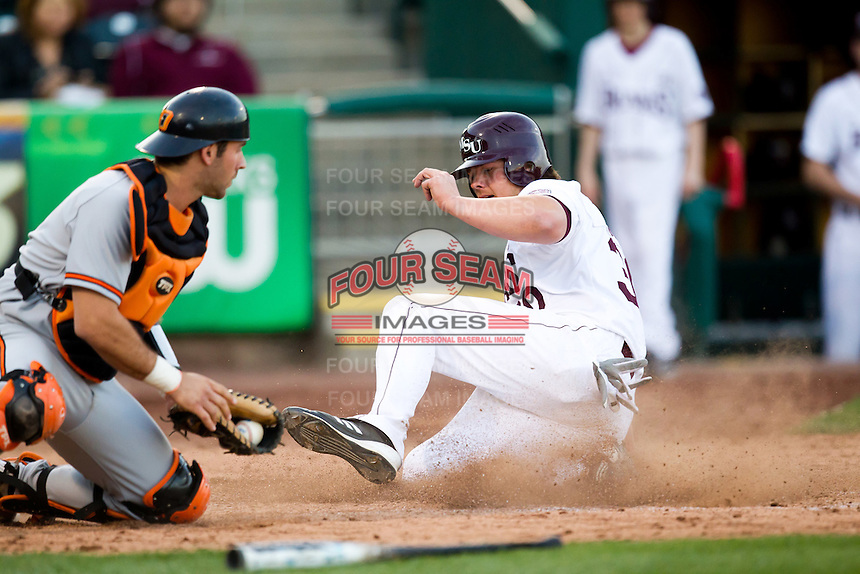 Luke Voit (30) of the Missouri State Bears slides safely into home plate during a game against the Oklahoma State Cowboys at Hammons Field on March 6, 2012 in Springfield, Missouri. (David Welker / Four Seam Images)
