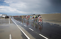 """a large 2nd peloton (1'20"""" behind) with yellow jersey Rohan Dennis (AUS/BMC) & some overall contenders such as Vincenzo Nibali (ITA/Astana), Nairo Quintana (COL/Movistar) &  Alejandro Valverde (ESP/Movistar) racing over the very wet Brouwersdam<br /> <br /> stage 2: Utrecht - Neeltje Jans (166km)<br /> 2015 Tour de France"""