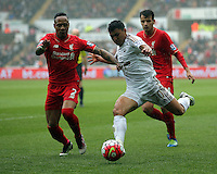 (L-R) Nathaniel Clyne of Liverpool challenges Jefferson Montero of Swansea City during the Barclays Premier League match between Swansea City and Liverpool at the Liberty Stadium, Swansea on Sunday May 1st 2016