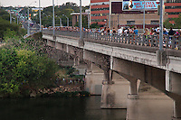 The Congress Avenue Bridge spans Town Lake in downtown Austin and is home to the largest urban bat colony in North America. The colony is estimated at 1.5 million Mexican free-tail bats. Each night from mid-March to November, the bats emerge from under the bridge at dusk to blanket the sky as they head out to forage for food. This event has become one of the most spectacular and unusual tourist attractions in Texas. The most spectacular bat flights are during hot, dry August nights, when multiple columns of bats emerge.