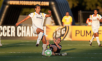Leslie Osborne (right) slide tackles Han Duan (left). FC Gold Pride tied the Los Angeles Sol 0-0 at Buck Shaw Stadium in Santa Clara, California on July 23, 2009.