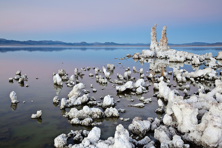 A tufa tower made from calcium-carbonate rises out of Mono Lake at the Mono Lake Tufa State Natural Reserve in California, USA