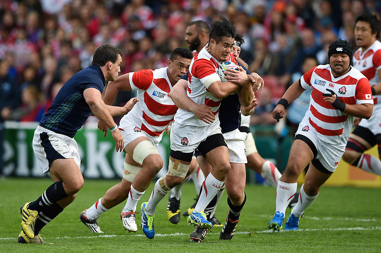 Yu Tamura of Japan goes on the attack. Rugby World Cup Pool B match between Scotland and Japan on September 23, 2015 at Kingsholm Stadium in Gloucester, England. Photo by: Patrick Khachfe / Stewart Communications