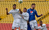 BOGOTA - COLOMBIA, 18-04-2021: Juan Pablo Vargas de Millonarios F. C. y Carlos Robles, Jorge Masiglia de Deportivo Cali disputan el balon durante partido entre Millonarios F. C. y Deportivo Cali de la fecha 19 por la Liga BetPlay DIMAYOR I 2021 jugado en el estadio Nemesio Camacho El Campin de la ciudad de Bogota. / Juan Pablo Vargas de Millonarios F. C. y Carlos Robles, Jorge Masiglia of Deportivo Cali figth for the ball during a match between Millonarios F. C. and Deportivo Cali of the 19th date for the BetPlay DIMAYOR I 2021 League played at the Nemesio Camacho El Campin Stadium in Bogota city. / Photo: VizzorImage / Edgar Cusguen / Cont.