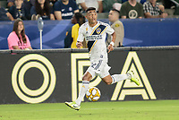 CARSON, CA - SEPTEMBER 21: Julian Araujo #22 of the Los Angeles Galaxy dribbles the ball during a game between Montreal Impact and Los Angeles Galaxy at Dignity Health Sports Park on September 21, 2019 in Carson, California.
