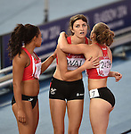 From left, Wales' Mica Moore, Hannah Thomas and Rachel Johncock after the 4x100m relay round 1 - heat 2<br /> <br /> Photographer Chris Vaughan/Sportingwales<br /> <br /> 20th Commonwealth Games - Day 9 - Friday 1st August 2014 - Athletics - Hampden Park - Glasgow - UK