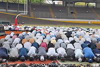 - muslim immigrants referring to  Islamic center of  Jenner avenue celebrate Friday prayer in Vigorelli Velodrome....- gli immigrati musulmani che fanno riferimento al centro Islamico di viale Jenner celebrano la preghiera del venerdì al Velodromo Vigorelli