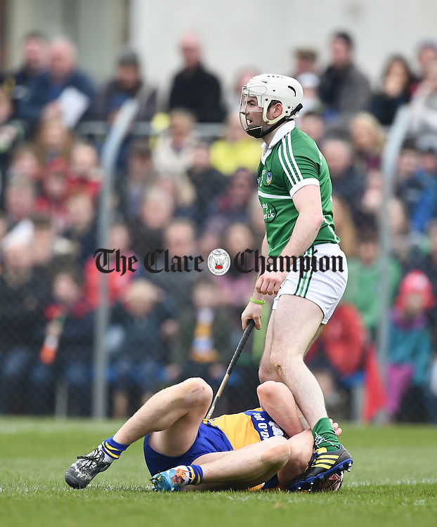 John Conlon of Clare is held between the legs of Limerick's Tom Condon during their Div. 1b Round 5 game in Cusack park. Photograph by John Kelly.