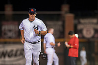 Scottsdale Scorpions manager Jay Bell (11), of the New York Yankees organization, jogs back to third base after visiting with Kyle Holder (43) and the team trainer during an Arizona Fall League game against the Mesa Solar Sox on October 23, 2017 at Scottsdale Stadium in Scottsdale, Arizona. The Solar Sox defeated the Scorpions 5-2. (Zachary Lucy/Four Seam Images)