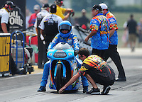 Jul, 10, 2011; Joliet, IL, USA: NHRA pro stock motorcycle rider L.E. Tonglet is led to the staging beams by brother G.T. Tonglet during the Route 66 Nationals at Route 66 Raceway. Mandatory Credit: Mark J. Rebilas-