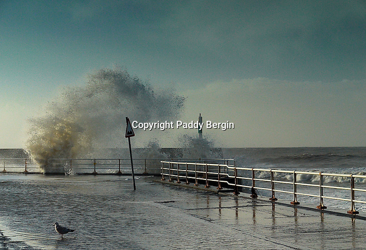 Storm waves batter Aberystwyth Promenade during Winter storms causing floods and damage.<br /> <br /> Stock Photo by Paddy Bergin