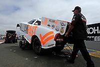 Jul. 31, 2011; Sonoma, CA, USA; Crew members push the car of NHRA funny car driver Brian Thiel during the Fram Autolite Nationals at Infineon Raceway. Mandatory Credit: Mark J. Rebilas-