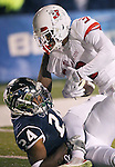 Fresno State's Josh Harper (3) scores against Nevada's Charles Garrett (24) during the first half of an NCAA college football game in Reno, Nev., on Saturday, Nov. 22, 2014. (AP Photo/Cathleen Allison)