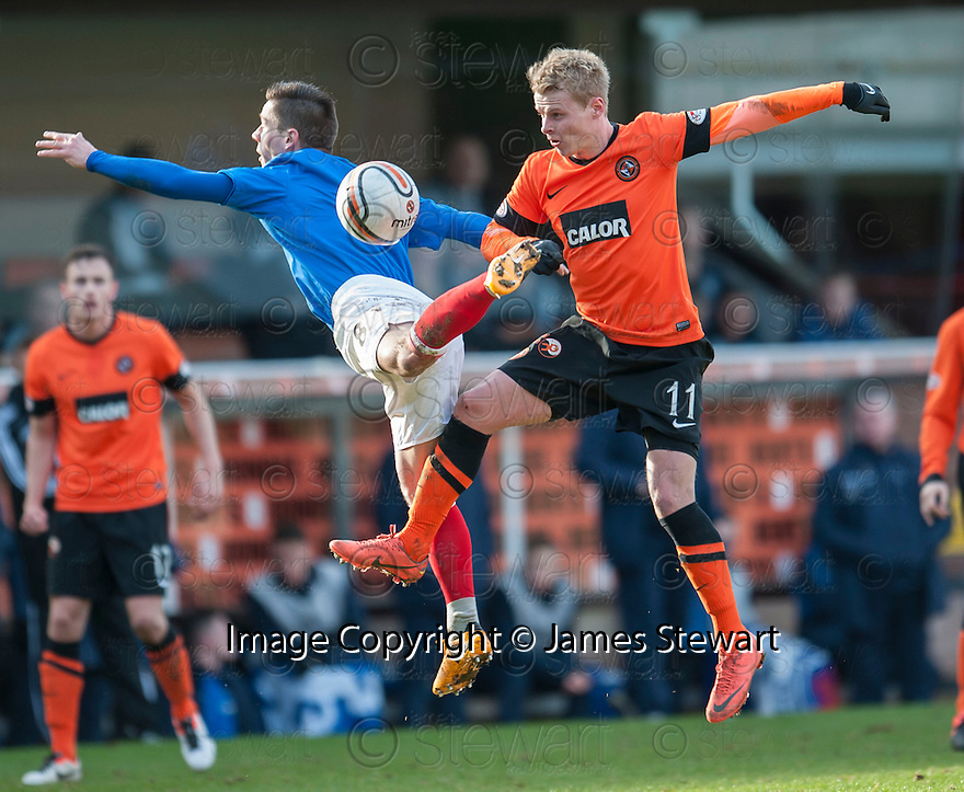 United's Gary Mackay Steven and Gers Ian Black challenge for the ball.