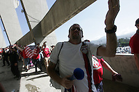 A United States fan blows a kiss to Mexican fans jeering them as they leave Azteca Stadium after the game. The United States Men's National Team played Mexico in a CONCACAF World Cup Qualifier match at Azteca Stadium in, Mexico City, Mexico on Wednesday, August 12, 2009.  Mexico won 2-1.