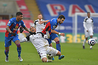 Kenny Tete of Fulham clashes with Luka Milivojević of Crystal Palace and Patrick van Aanholt of Crystal Palace during the Premier League behind closed doors match between Crystal Palace and Fulham at Selhurst Park, London, England on 28 February 2021. Photo by Vince Mignott / PRiME Media Images.