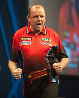 20.12.2014.  London, England.  William Hill World Darts Championship.  Ronny Huybrechts [BEL] celebrates a finish during his game with Andy Smith (28) [ENG].  Huybrechts won the match 3-0.