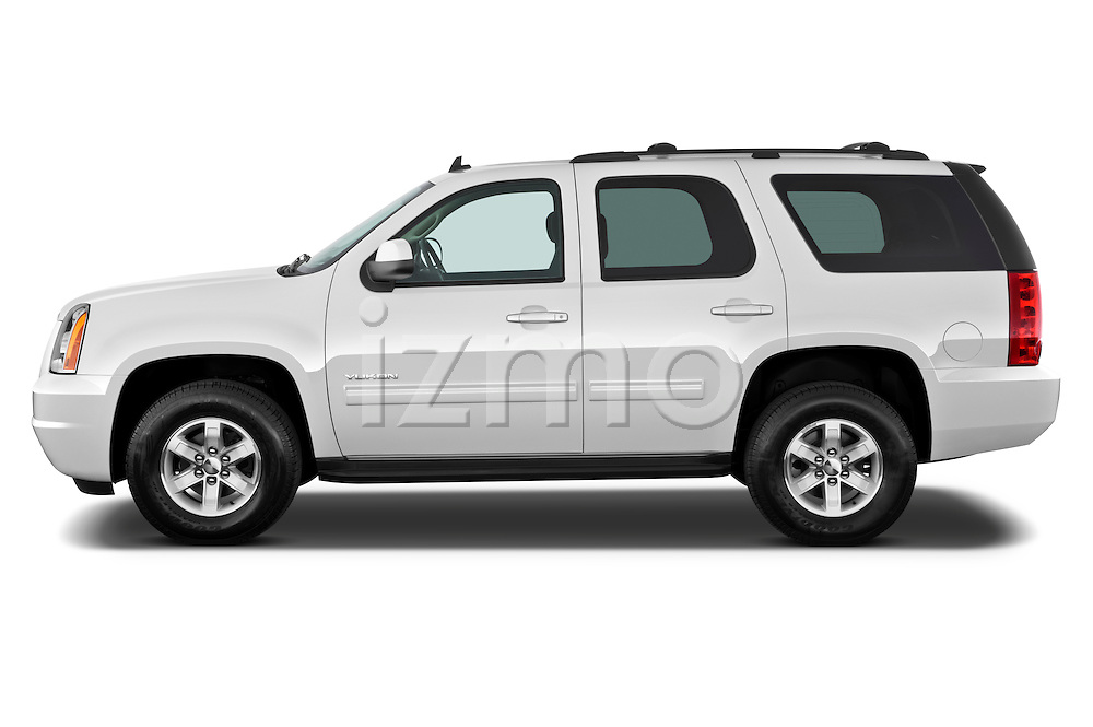 Driver side profile view of a 2012 GMC Yukon SLE.