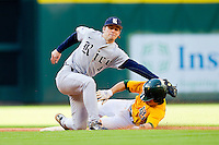 Shortstop Derek Hamilton #4 of the Rice Owls reaches for a wide throw as Landis Ware #5 of the Baylor Bears slides into second base at Minute Maid Park on March 6, 2011 in Houston, Texas.  Photo by Brian Westerholt / Four Seam Images