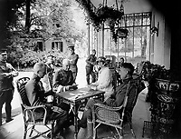 Wounded officers and Mrs. W.E.  Corey, wife of the American steel magnate, who has given her home to wounded American officers.  A game of bridge in progress on the veranda.  Chateau de Villegenis at Palaiseau, France.  September 18, 1918.  Sgt. R. Sullivan. (Army)<br />NARA FILE #:  111-SC-23400<br />WAR & CONFLICT BOOK #:  657