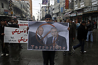 "Palestinians hold posters of U.S. President George W. Bush and Israeli Prime Minister Ehud Olmert during a protest, ahead of the Bush visit to the region, in Gaza City, Tuesday, Jan. 8, 2008. Israeli and Palestinian leaders met on Tuesday, a day ahead of U.S. President George W. Bush's arrival in the region, to try to wring some sort of progress from talks that have barely advanced since a U.S.-sponsored Mideast peace conference.""photo by Fady Adwan"""