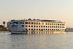 A cruise boat on the River Nile at Luxor.The town of Luxor occupies the eastern part of a great city of antiquity which the ancient Egytians called Waset and the Greeks named Thebes.