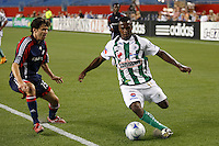 Santos Laguna forward Christian Benitez (11) is marked by New England Revolution defender Michael Parkhurst (15). The New England Revolution defeated Santos Laguna 1-0 during a Group B match of the 2008 North American SuperLiga at Gillette Stadium in Foxborough, Massachusetts, on July 13, 2008.