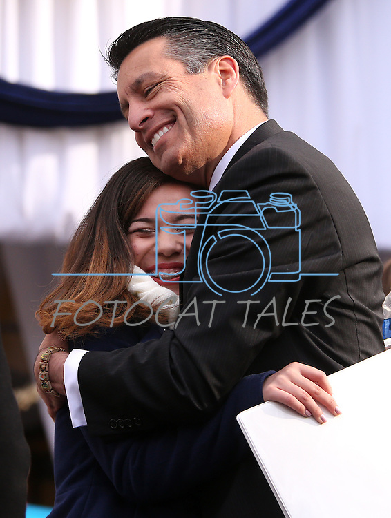 Gov. Brian Sandoval hugs Inauguration Mistress of Ceremonies Ayleen Perry, of Las Vegas, following the ceremony at the Capitol, in Carson City, Nev., on Monday, Jan. 5, 2015.<br /> Photo by Cathleen Allison