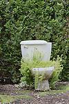 Toilet used as planter in botanical garden.  Entertainment in the Children's Garden at Oregon Gardens.  Oregon Gardens, Silverton, Oregon, USA, an 80 acre botanical garden in the Willamette Valley.