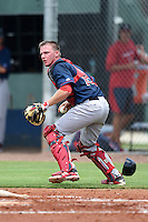 GCL Red Sox catcher Simon Gravel (15) checks the runner during a game against the GCL Rays on June 24, 2014 at Charlotte Sports Park in Port Charlotte, Florida.  GCL Red Sox defeated the GCL Rays 5-3.  (Mike Janes/Four Seam Images)