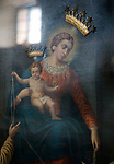 Madonna and child. (Detail) Seen through protective glass. Raised gold crowns. The Madonna Rosario. Tuscany Italy.