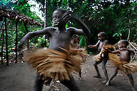 Boys are going thru the end of the circumcision ceremony called Kumbi.  The boys always wear the ceremonial skirts for their circumcision ceremonies and the girls as well.  When they take off the skirts at the end of the ceremony, they will be hung in the trees.