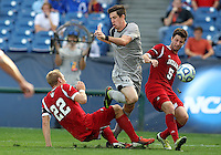 HOOVER, AL - DECEMBER 09, 2012: Caleb Konstanski (22), and Matt McKain (5) of Indiana University close down Jimmy Nealis (16) of Georgetown University during the NCAA 2012 Men's College Cup championship, at Regions Park, in Hoover , AL, on Sunday, December 09, 2012.
