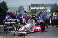Jul, 10, 2011; Joliet, IL, USA: NHRA top fuel dragster crew members for driver Shawn Langdon during the Route 66 Nationals at Route 66 Raceway. Mandatory Credit: Mark J. Rebilas-