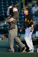 Bradenton Marauders manager Michael Ryan (12) argues a call as umpire Kirk Struble throws him out of the game against the Charlotte Stone Crabs on April 22, 2015 at McKechnie Field in Bradenton, Florida.  Bradenton defeated Charlotte 7-6.  (Mike Janes/Four Seam Images)