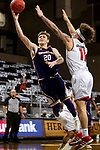 SIOUX FALLS, SD - MARCH 6: Colton Sandage #20 of the Western Illinois Leathernecks lays the ball up past Mason Archambault #11 of the South Dakota Coyotes during the Summit League Basketball Tournament at the Sanford Pentagon in Sioux Falls, SD. (Photo by Dave Eggen/Inertia)