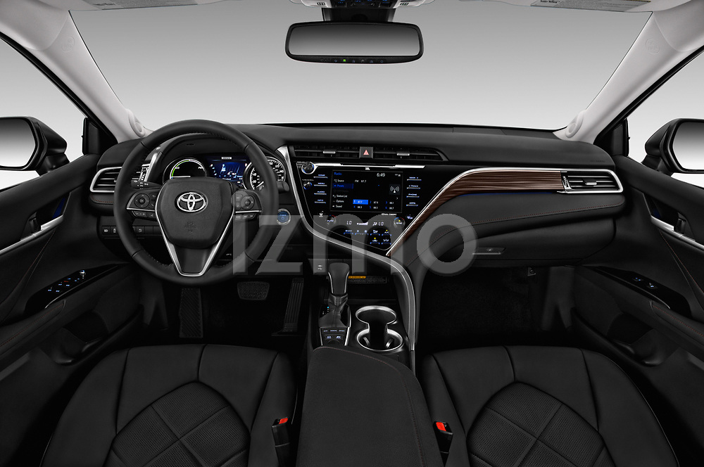 Stock photo of straight dashboard view of a 2019 Toyota Camry XLE Hybrid 4 Door Sedan