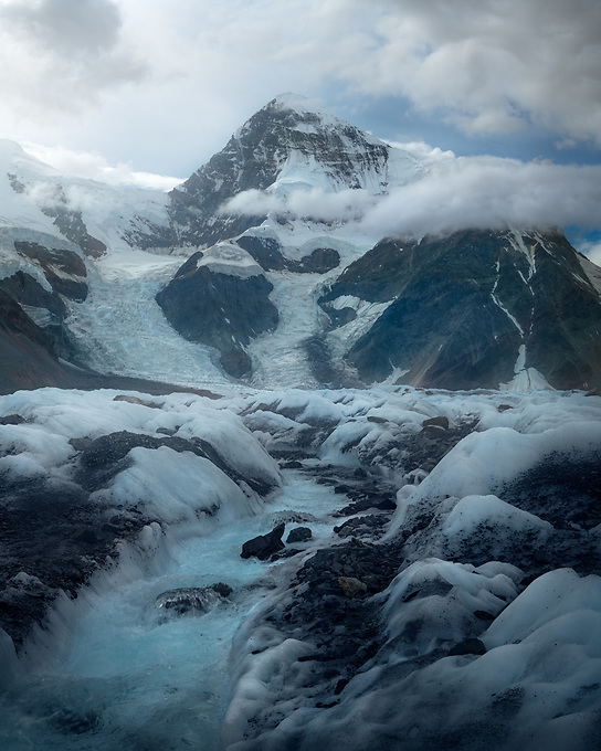 A stream of aquamarine glacial runoff leads to one of the most photogenic mountains I have ever seen, photographed here in soft mid morning light. This scene melted into a pile of rubble in the summer sun just the next day.