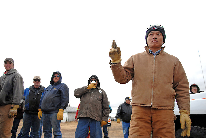 Sheldon Zou bids during an auction at a farm near Ogema, Sask. Zou immigrated from China to Ogema in 2008 with his his wife and two daughters. This story was the first one I'd shot that ended up on the front page of the Globe and Mail.