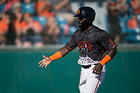 San Jose Giants left fielder Jacob Heyward (33) is congratulated by a teammate after scoring a run during a California League game against the Lancaster JetHawks at San Jose Municipal Stadium on May 12, 2018 in San Jose, California. Lancaster defeated San Jose 7-6. (Zachary Lucy/Four Seam Images)