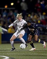 "Boston College midfielder Julia Bouchelle (12) attempts to control the ball as West Virginia midfielder Ashtin Larkin (5) pressures. Boston College defeated West Virginia, 4-0, in NCAA tournament ""Sweet 16"" match at Newton Soccer Field, Newton, MA."