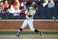 Nick DiPonzio (7) of the Wake Forest Demon Deacons makes contact with the baseball during the game against the Gardner-Webb Runnin' Bulldogs at David F. Couch Ballpark on February 18, 2018 in  Winston-Salem, North Carolina. The Demon Deacons defeated the Runnin' Bulldogs 8-4 in game one of a double-header.  (Brian Westerholt/Four Seam Images)