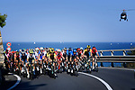 The peloton ride along the Ligurian coast during the 111th edition of Milan- San Remo 2020, running 305km from Milan to San Remo, Italy. 8th August 2020.<br /> Picture: LaPresse/Fabio Ferrari | Cyclefile<br /> <br /> All photos usage must carry mandatory copyright credit (© Cyclefile | LaPresse/Fabio Ferrari)