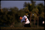 Tiger Woods swings away from the bunker at the Genuity Open at Doral in Miami, Fl.