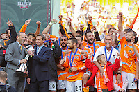 Houston Dynamo players react as they are about to be presented with the Alan I. Rothenberg Trophy by MLS Commissioner Don Garber. The Houston Dynamo defeated the New England Revolution 2-1 in the finals of the MLS Cup at RFK Memorial Stadium in Washington, D. C., on November 18, 2007.