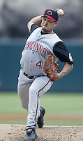 Elmer Dessens of the Cincinnati Reds pitches during a 2002 MLB season game against the Los Angeles Angels at Angel Stadium, in Anaheim, California. (Larry Goren/Four Seam Images)