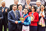 Jockey Joao Moreira, who rides Rapper Dragon, receives the prize after winning 2017 BMW Hong Kong Derby Race at the Sha Tin Racecourse on 19 March 2017 in Hong Kong, China. Photo by Marcio Rodrigo Machado / Power Sport Images