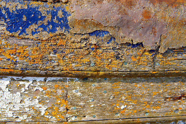 Close up of paint and wood  textures on old wooden fishing boats