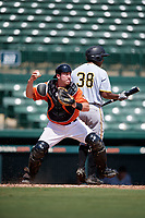 Baltimore Orioles catcher Ben Breazeale (79) throws down to second base with Raul Hernandez (38) at bat during an Instructional League game against the Pittsburgh Pirates on September 27, 2017 at Ed Smith Stadium in Sarasota, Florida.  (Mike Janes/Four Seam Images)