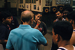 INDIA (West Bengal - Calcutta)July 2007, Shakila Babe after practice talking with her coach at Sports Authority of India Complex (East Zone) in Kolkata. Shakila and Shanno are twins from a poor muslim family of Iqbalpur, Kolkata. . Inspite of their late father's unwillingness to send his daughters to take up  boxing her mother Banno Begum inspired them to take up boxing at the age of 3. Their father was more concerned about the social stigma they have in their community regarding women coming into sports or doing anything which may show disrespect to the religious emotions of his community. Shakila now has been recognised as one of the best young woman boxers of the country after she won the  international championship at Turkey in the junior category. Shanno is also been called for the National camp this year. Presently Shakila and shanno has become the role model in the Iqbalpur area  and parents from muslim community of Iqbalpur have started showing interst in boxing. Iqbalpur is a poor muslim dominated area mostly covered with shanty town with all odds which comes along with poverty and lack of education. - Arindam Mukherjee